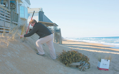 Donnie King working to preserve the beach. Photo K. Wilkins Photography.