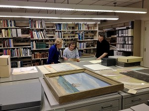 Sec. Kluttz explores the Outer Banks History Center's collections with OBHC Site Manager KaeLi Schurr and Archivist Stuart Parks. Photo, N.C. Department of Cultural Resources.