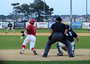 That's a base hit for the man in red--an Outer Banks Daredevil. Photo, Kip Tabb