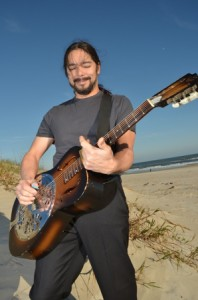 Lou Castro with a dobro. One of many instruments he plays.