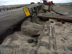 Damage to NC12 north of the temporary bridge in Pea Island National Wildlife Refuge. Credit, NCDOT.
