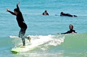 Teaching a cancer survivor to surf. Photo, Farmdog Surf School.