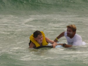 In the water and learning to surf.