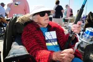 Elsa Jennings from Henderson County, fishes grin Avalon Fishing Pier. The 100-year-old woman ldest participant in the VIP Fishing Tournament. Photo: Michael H. Schwartz/Thin Blue Line Productions