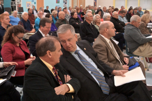 Transportation Board member Malcolm Fearing, foreground, confers with state Rep. Bob Steinburg. District 1 highway engineer Jerry Jennings is to their left. Photo, Russ Lay