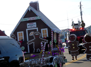 Winner of Most Creative float, Midgett Realty's Gingerbread House.