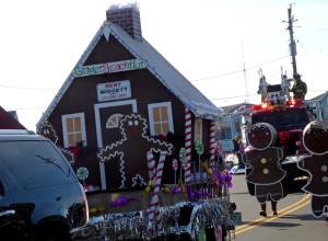 Winner of Most Creative float, Midgett Realty's Gingerbread House.