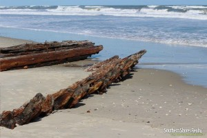 exposed shipwreck on the beach