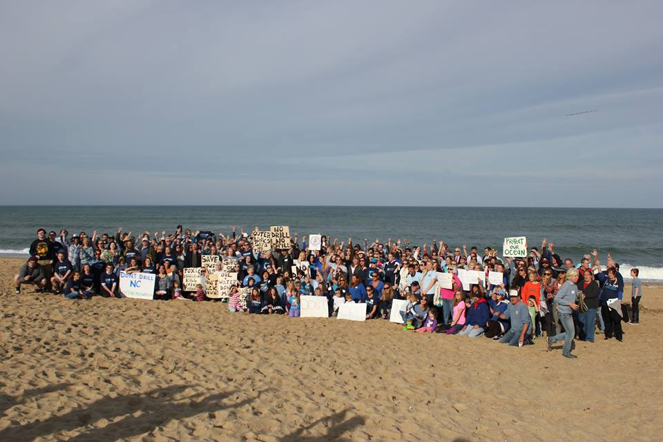 people rally on the beach