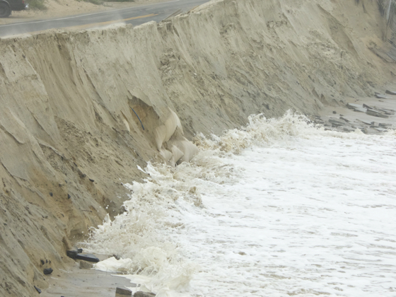 Sandbags exposed by wave action at repaired section of the Beach Road. Photo, Kip Tabb