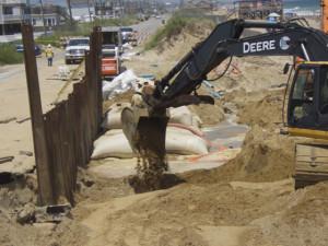 Sandbags and retaining wall, July 2015. Photo, Kip Tabb