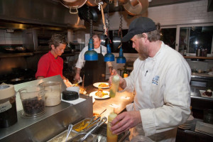 Hard at work in the kitchen. Photo, Outer Banks Voice.