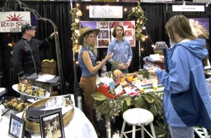 Two of the many vendors at the Wedding Expo 2016. Newcomer Camp Cocktail next to Wes Stepp of Red Sky Cafe.