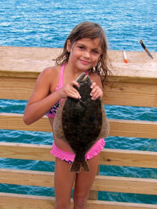 Young angler with her catch at Jennette's Pier. Photo, Jennette's Pier