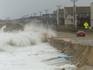 Waves breaking over Beach Road by Kitty Hawk Bathhouse. The waves undercut the road, and it's now closed waiting for repairs. Photo Kip Tabb