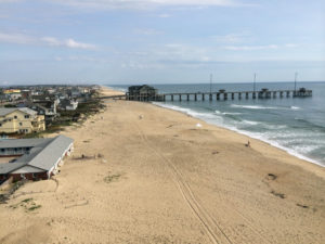 An effective use of beach nourishment. Photo taken 3 years after Nags Head nourishment project. The old high water mark was inside the tire tracks.