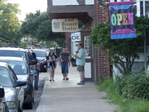 Downtown Manteo in the summer showing the Pioneer Theater, the oldest family owned theater in the nation. Photo Kip Tabb