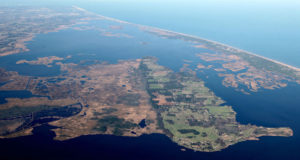 Aerial view of Knotts Island and the northern Currituck Banks. Fan shaped islands on the right side of the image indicate silt deposits after ocean overwash.