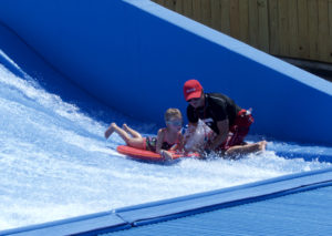 Getting some instruction at the Endless Flow Wave Rider. Photo Kip Tabb