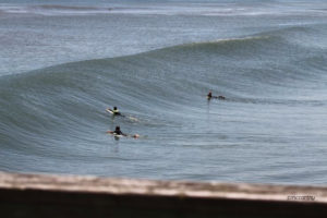 A Mickey McCarthy picture. Surfers at Avalon Pier, Kill Devil Hills, NC.