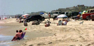 Summer sunbathers on Carova Beach by entrance to the 4WD area. Photo, Virginia Pilot